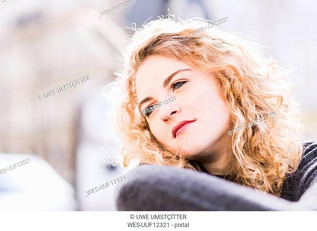 Portrait of daydreaming young woman