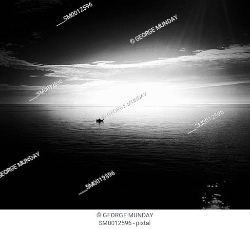 A lone fishing boat in the Mediterranean Sea off Nerja, . Costa del Sol, Malaga Province,. Andalucia, Spain.
