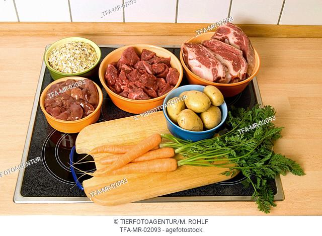Feeding on meat Stock Photos and Images | age fotostock