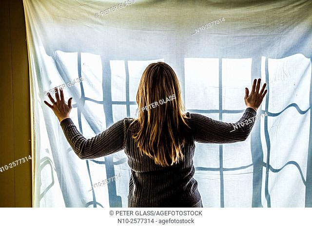 Woman in front of a window