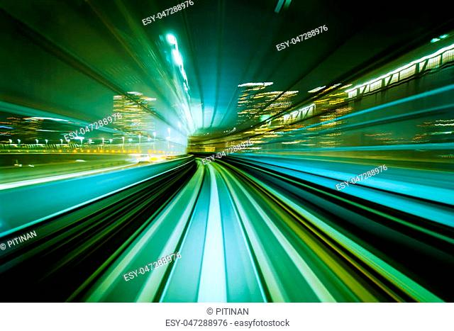 Motion blurred front view of train running in modern city tunnel. Abstract transportation background