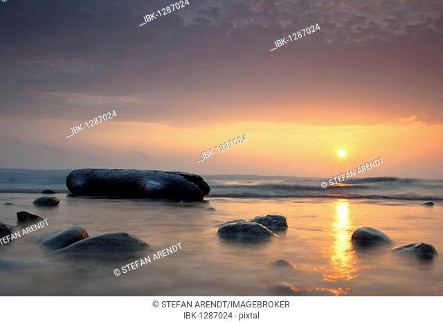 Sunrise on Lake Constance with a piece of flotsam made of wood, Konstanz, Baden-Wuerttemberg, Germany, Europe