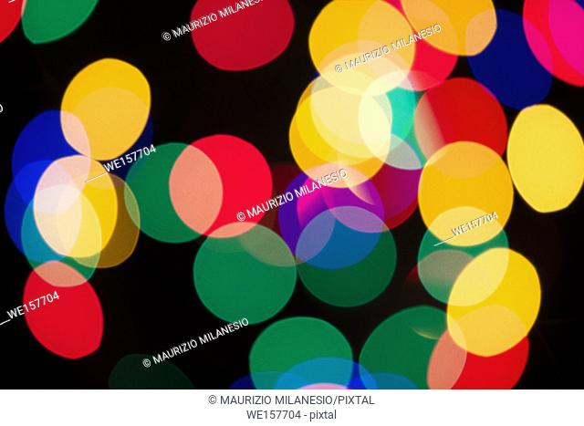 Blurry multicolored spherical lights on black, can use background