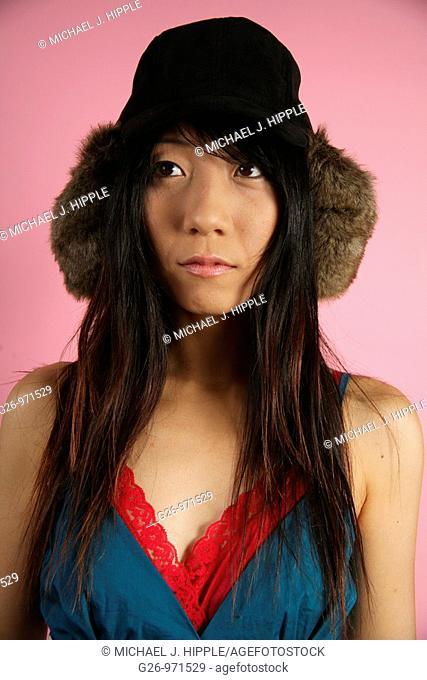 Asian-American woman looking thoughtful