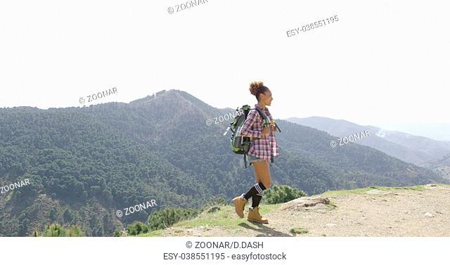 Female traveler backpacking in summer
