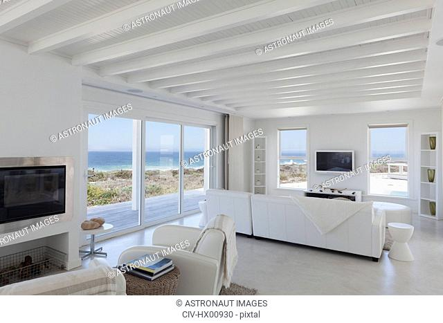 Beach house living room with wood beam ceilings