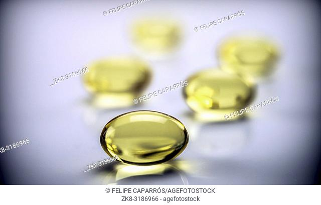 Capsules of fish oil with three omega, conceptual image