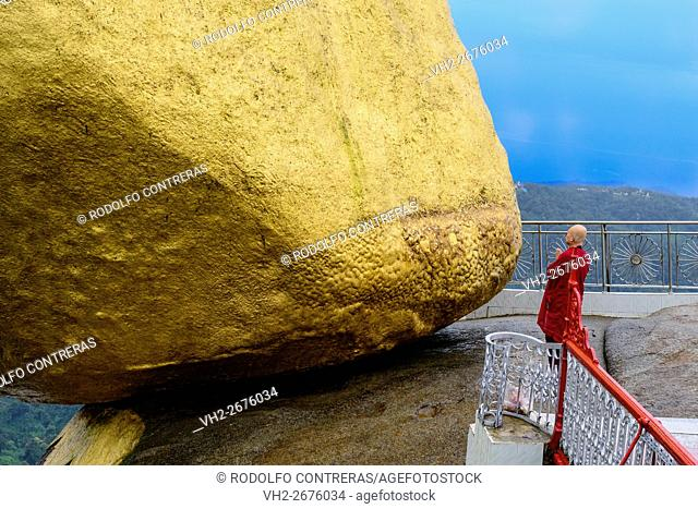 Monk praying at the Golden Rock, Myanmar