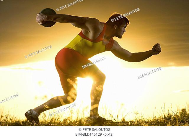 Caucasian athlete preparing to throw discus