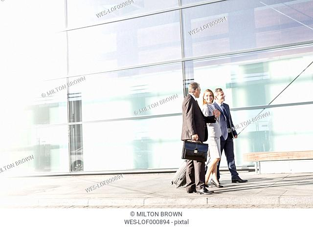 Businesspeople walking outside airport building