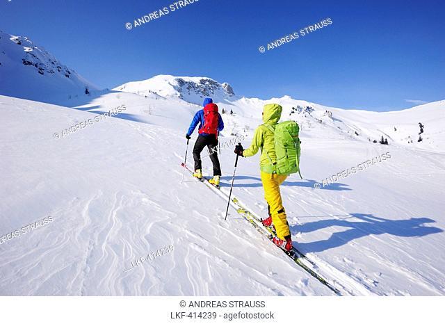 Two cross-country skier ascending to mount Sulzspitze, Tannheim Mountains, Allgaeu Alps, Tyrol, Austria
