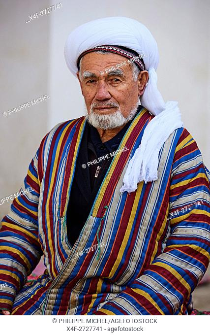 Uzbekistan, Bukhara, Unesco world heritage, Uzbek men playing chess in traditional clothes chapan