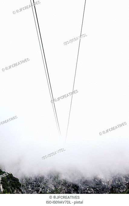 Cable car wires disappearing into mist, Brand, Vorarlberg, Austria