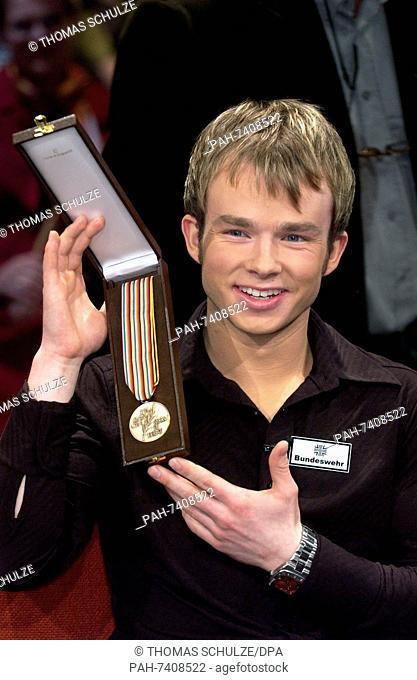 (dpa) - German figure skater Stefan Lindemann shows his recently won bronze  medal during a talkshow in Leipzig 650af464c