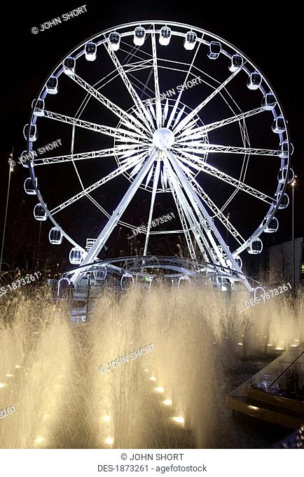 middlesbrough, north yorkshire, england, a ferris wheel and fountains illuminated at night