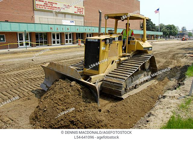 large industrial bullldozer road making machinery and equipment is used to make a new paved street