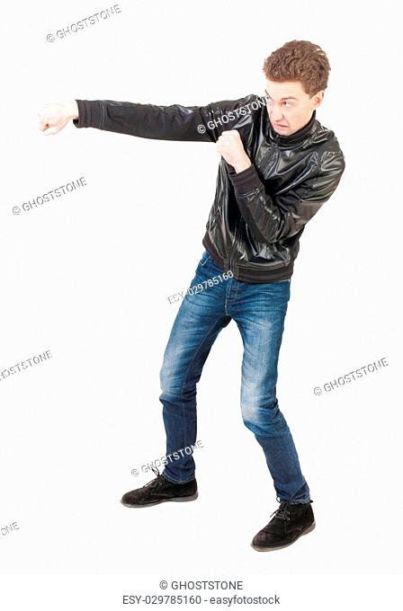 skinny guy funny fights waving his arms and legs. Isolated over white background. Man shoots with his right hand