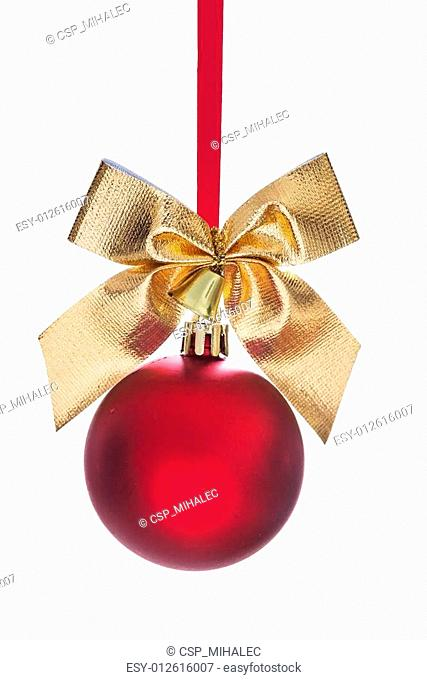 hanging red christmas bauble with gold colored bow and small bel