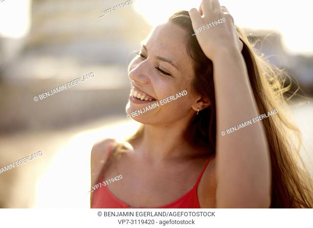 portrait of woman at beach in beautiful sunlight in holiday destination Chersonissos, Crete, Greece