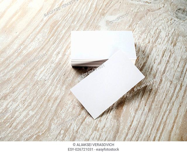 Blank business cards. Photo of blank business cards on on light wooden table background. Template for ID. For design portfolios