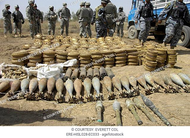 Iraqi National Police and US soldiers discover a weapons cache of 29 120-mm mortar rounds 466 2.2 mines 75 2.4 mines seven Chinese 107-mm rockets and five...