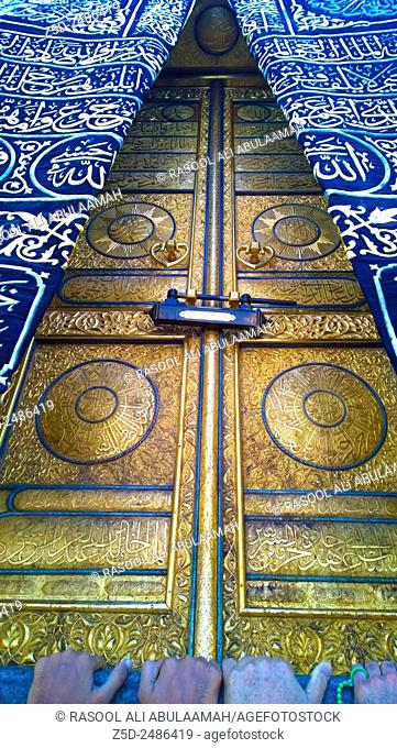 Picture of the door of Kaaba, its golden Inscribed with Koranic verses and decorations