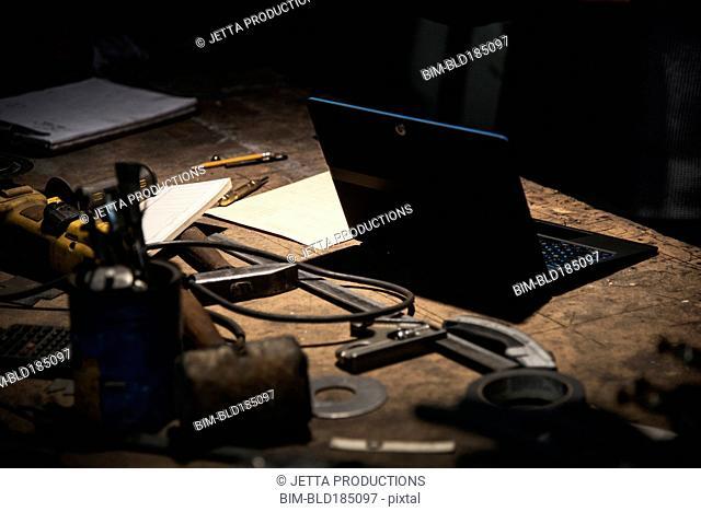 Laptop on workbench in factory