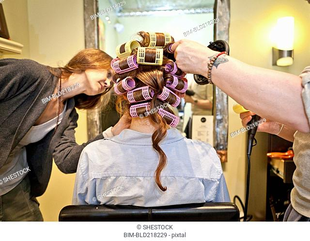 Woman having hair styled in salon