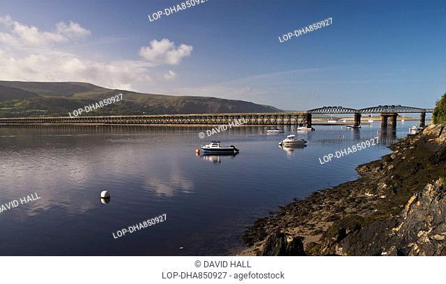 Wales, Gwynedd, Mawddach Estuary, A panoramic view of Barmouth Bridge Pont Abermaw which spans the Afon Mawddach river between Morfa Mawddach and Barmouth