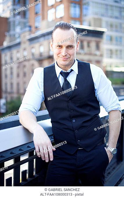 Businessman on balcony, portrait