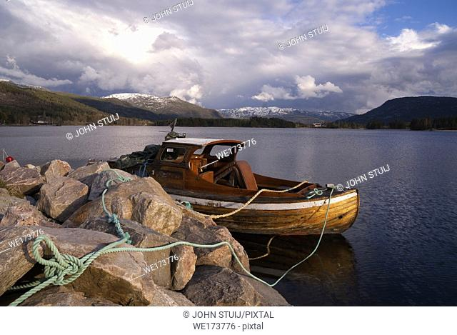 Boat in lake Nisser near Vradal in front of a dramatic sky