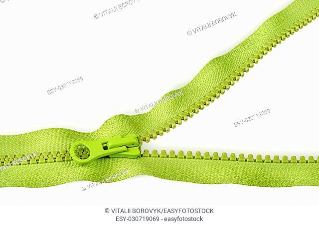 Partially unbuttoned fastener horizontally isolated on white background