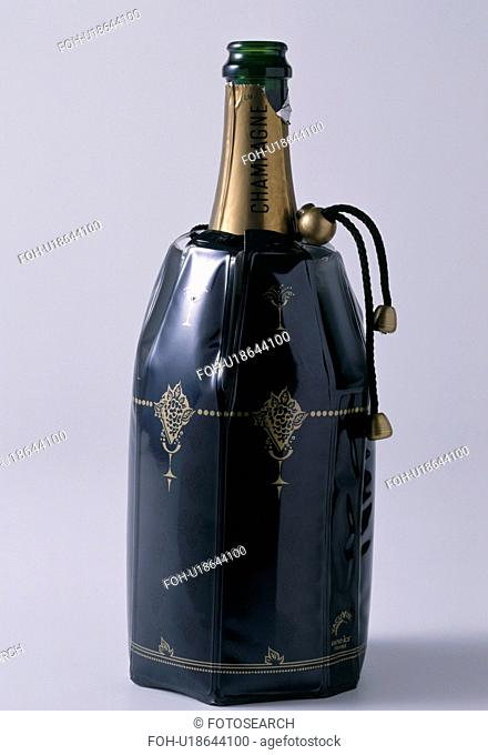 Close-up of bottle of champagne in black plastic cooler