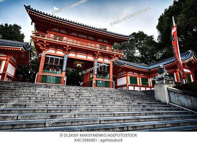 Yasaka shrine, Yasaka-jinja bright orange main entrance gate low angle view in morning sunrise Gion, Kyoto, Japan