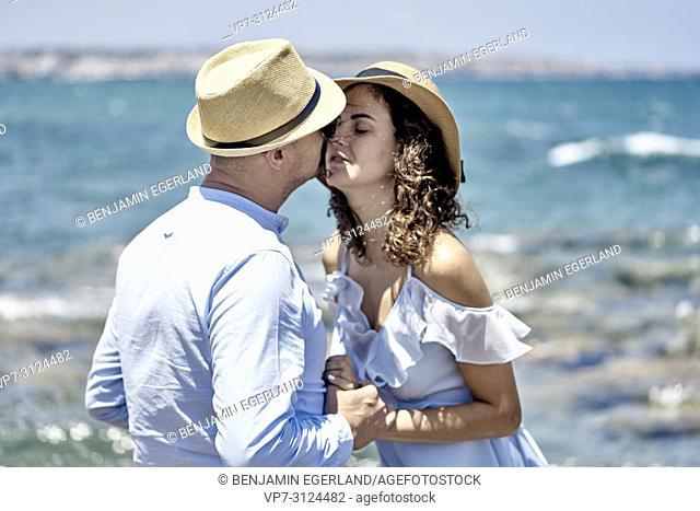 lovers at seaside, holiday, enjoying summer, couple