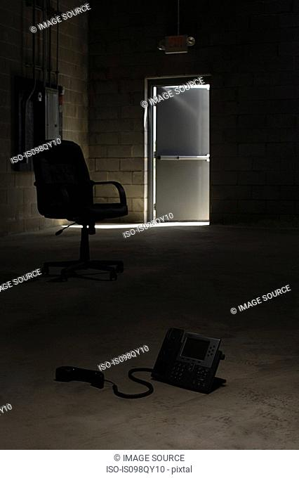 Chair and telephone in warehouse