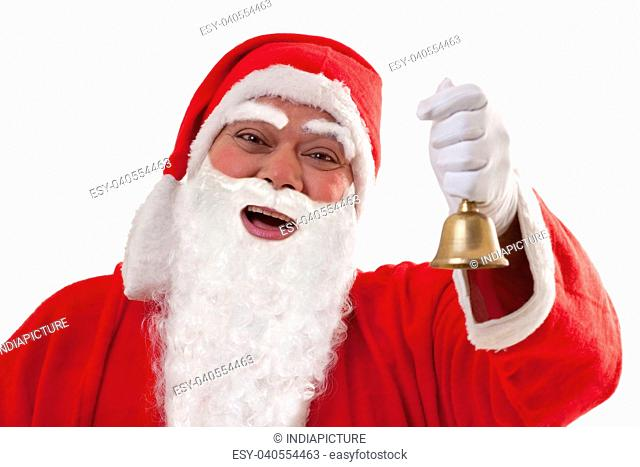 Close up portrait of cheerful Santa Claus ringing bell over white background