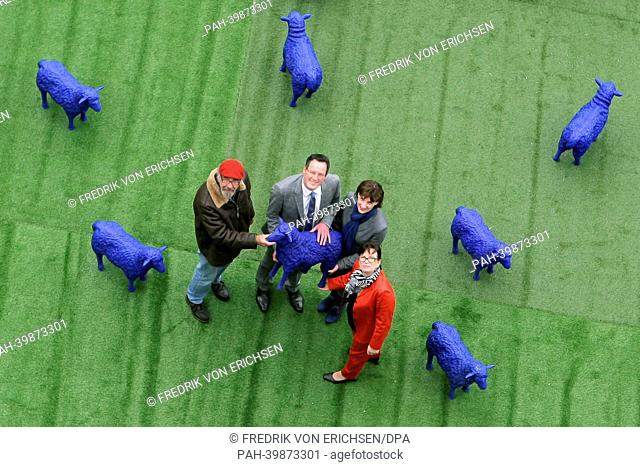 """Artist Bertamaria Reetz (R) and Rainer Bonk (L) pose among their art project """"""""BlueSheep"""""""" with LordMayor of Mainz Michael Ebling and his city councillor for..."""