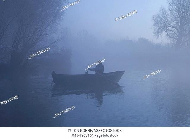man in mist in national park 'de biesbosch' in Holland