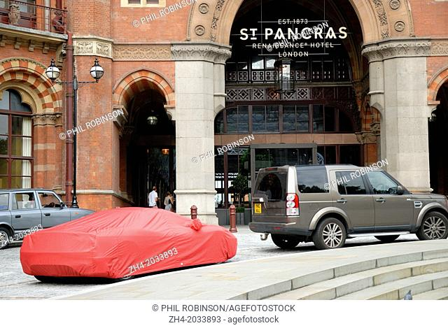 London, England, UK. Car under red cover outside St Pancras Station
