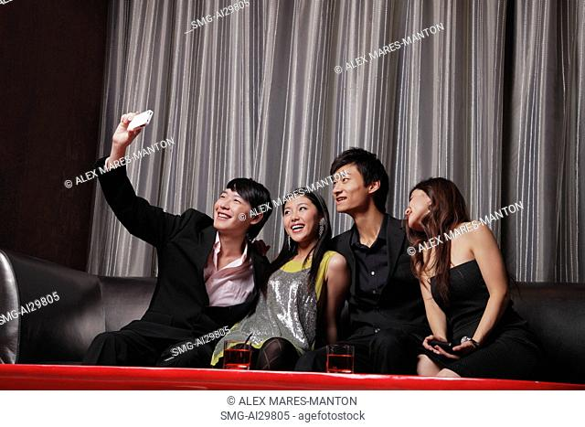 A group of friends take a photo of each other