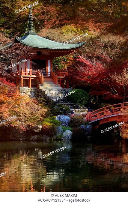 Bridge and steps leading to Bentendo Hall, autumn scenery with a pond. Daigo-ji temple, Shimo-Daigo part of Daigoji complex in fall colors