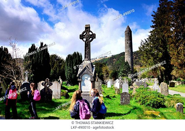 Graveyard with celtic cross, Glendalough in the Wicklow Mountains, South of Dublin, County Wicklow, Ireland