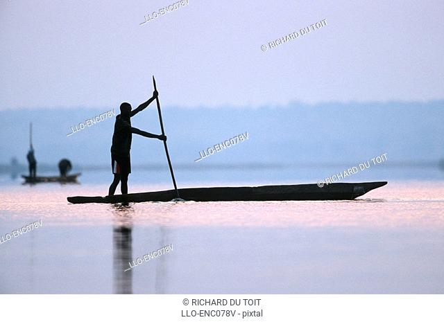 Silhouette of a Fisherman on a Mokoro  Chobe River, Namibia