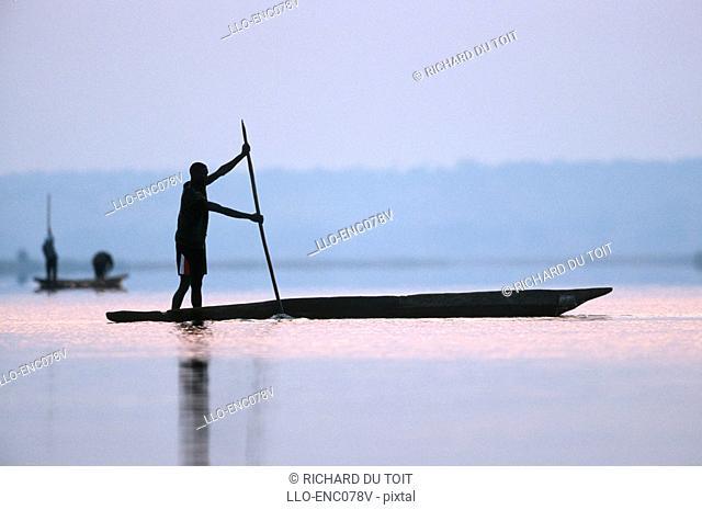 Silhouette of a Fisherman on a Mokoro  Chobe River, Namibia