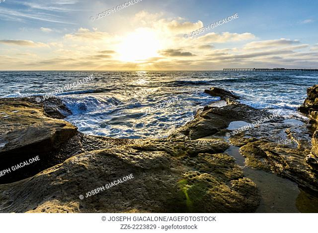 Sun setting over the ocean viewed from the Ocean Beach cliff area. San Diego, California, United States