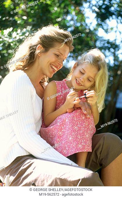 mother & daughter aplying nail polish