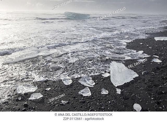 Sunrise over famous diamond beach Iceland this sand lava beach