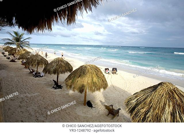 Tourists gather on a beach along the Mayan Riviera in the ancient Mayan city of Tulum in Mexico's Yucatan Peninsula