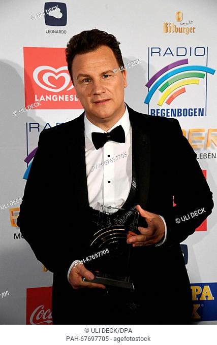 Presenter and designer Guido Maria Kretschmer poses with his award for the 'Radio Regenbogen Award' at Europa-Park in Rust, Germany, 22 April 2016